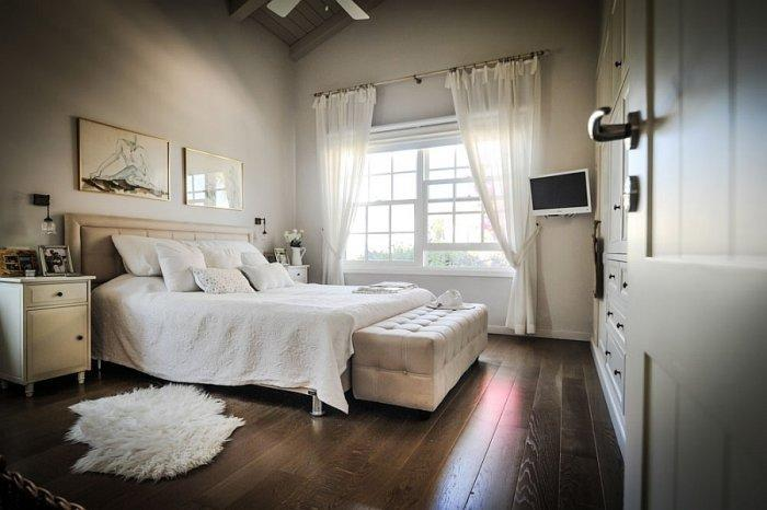 Traditional bedroom with solid wood floor and white bedside table