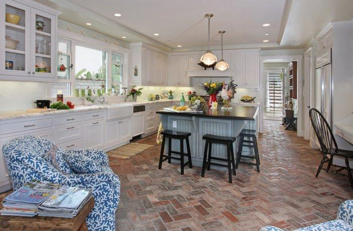 Traditional kitchen interior with spacious island and beautiful white cabinets