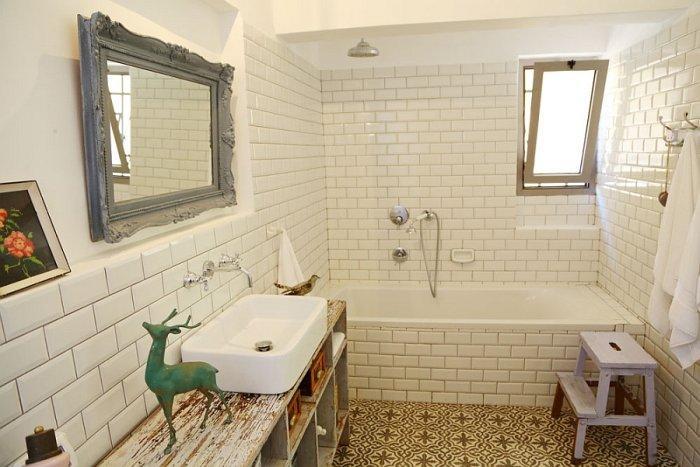 Vintage bathroom with white bathtub and worn out bathroom vanity