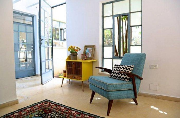 Vintage corner of the home with blue armchair and yellow drawer