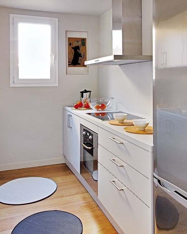 White kitchen with modern minimalist design and wooden floor