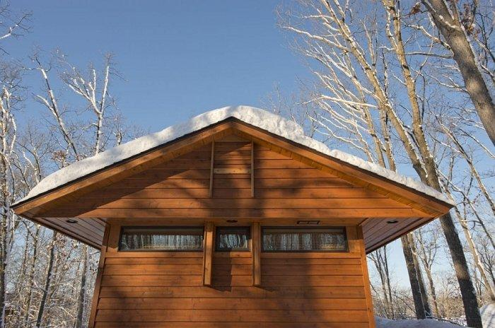 Wooden forest house and its roof design and facade cladding