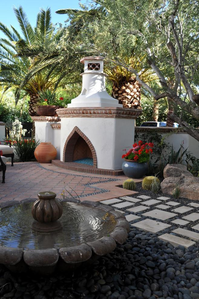Arabic Mediterranean style inside a garden with small decorative fountain and an outside furnace