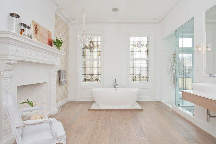 Eclectic bathroom in white with fireplace