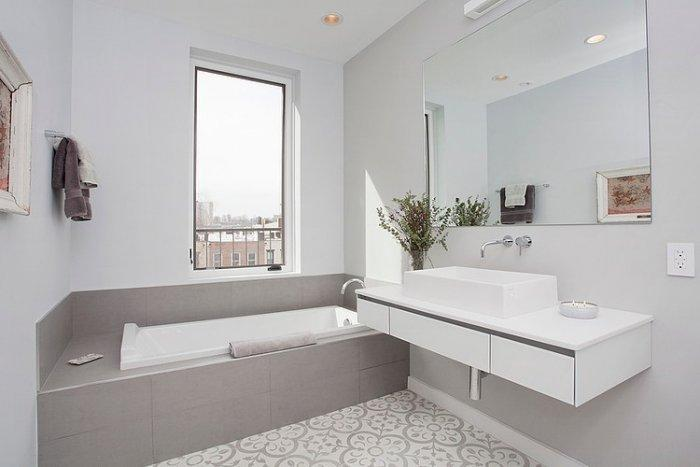Eclectic bathroom with grey bathtub
