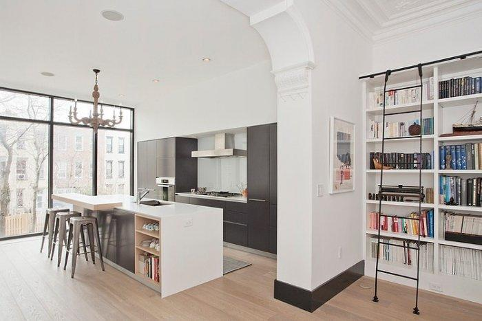Eclectic kitchen and home library in white