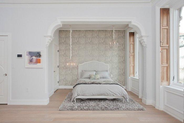 Eclectic white bedroom with traditional accents