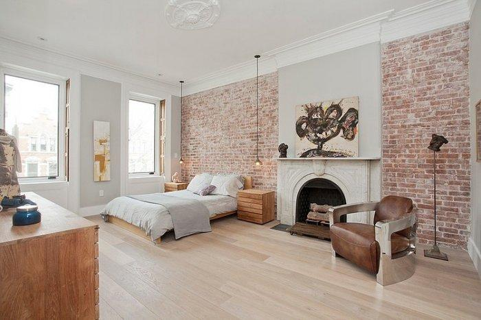 Ecletic bedroom in white with brick walls