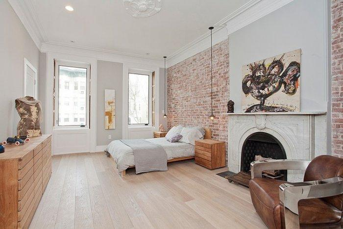 Ecletic bedroom with brick walls and white interior