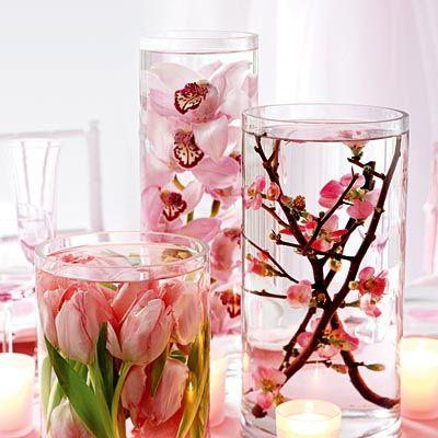 Flowers inside vessels full of water and placed on a table