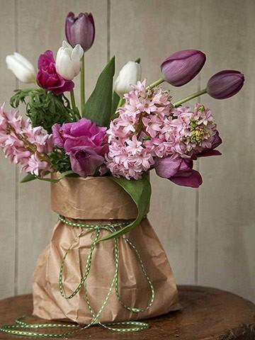 Fresh tulips placed in a paperbag instead of a traditional vase