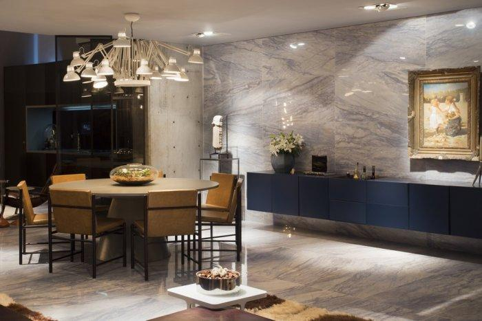 Luxury loft dining room with marble walls and contemporary pieces of art