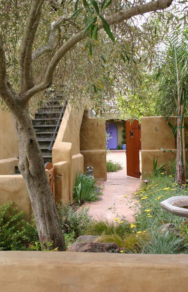 mediterranean garden with entrance door leading inside the house