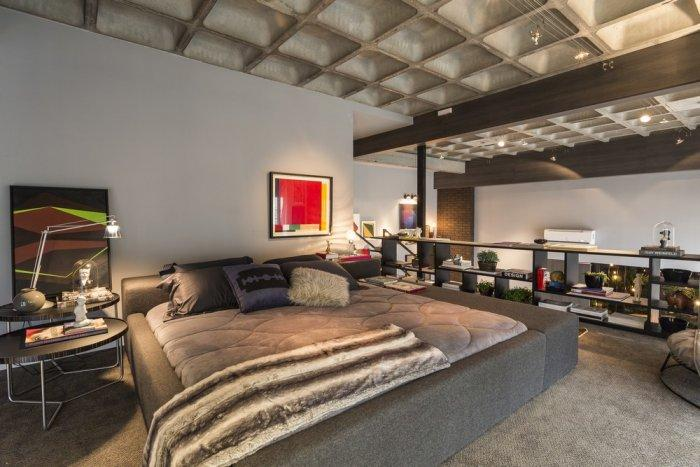 Modern loft bedroom with open wall towards the main volume of the property