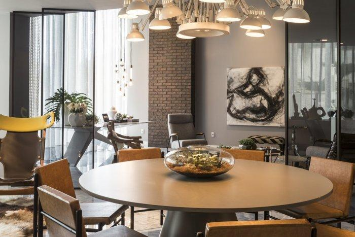 Modern loft dining room with stylish round table and interesting pendant