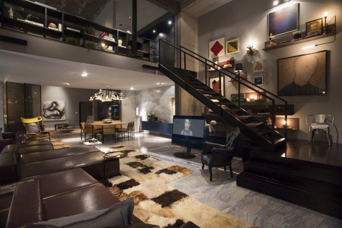 Modern open plan loft with stairs leading to the second floor
