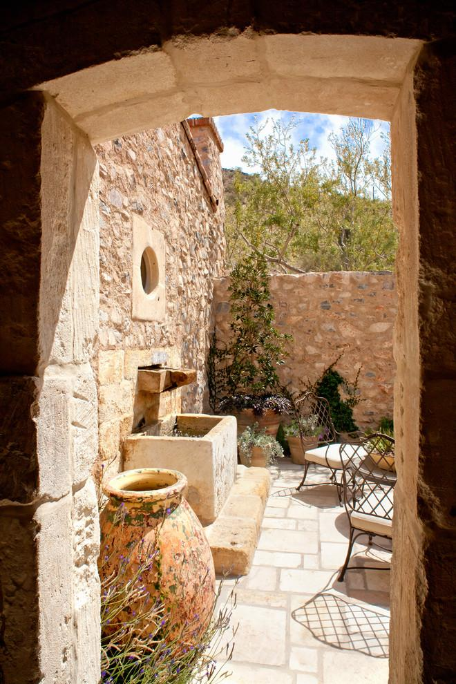 Moroccan garden design with the typical for the culture clay vessels for water