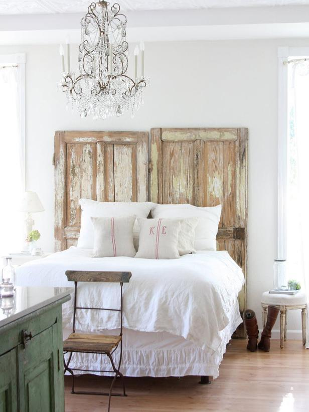 Shabby chic bedroom with two vintage doors instead of bed headboard