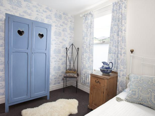 Shabby chic bedroom with vintage blue wardrobe