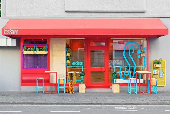 Small restaurant facade in red colors and colorful accents