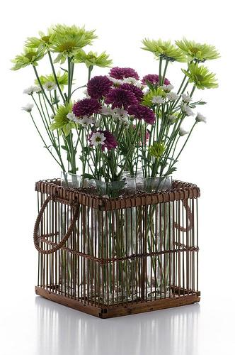 Spring flowers inside a knit basket that can be used in the living room