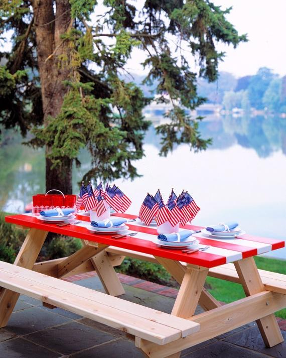 Striped Picnic Table in red and white stripes with blue accents on the top