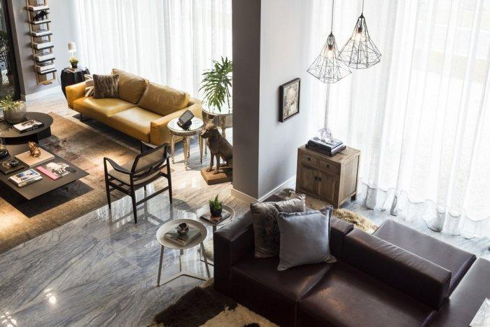 The main open plan living area with contemporary leather furniture and small decorative accents
