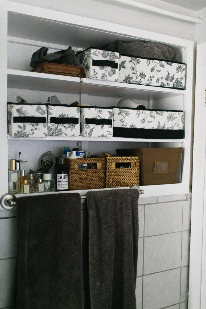 Bathroom storage boxes with various stuff in them