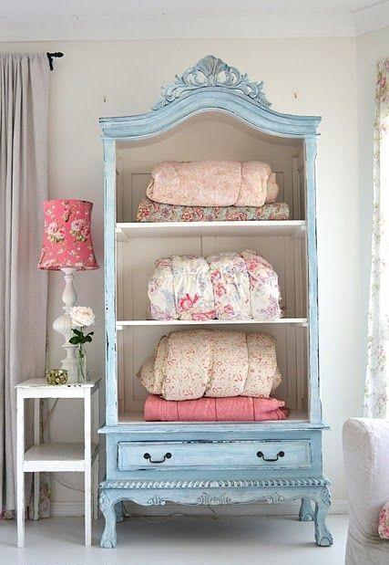 Blue storage chest in a bedroom closet