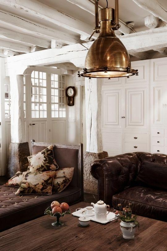 Brown rustic living room with industrial metal pendant