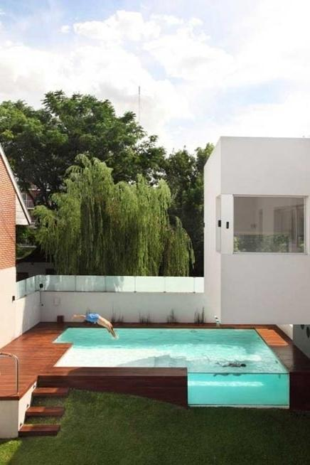 Contemporary Pool With Glass Side