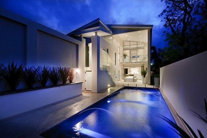 Contemporary swimming pool photographed at night