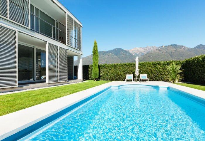 Contemporary swimming pool with two lounge chairs