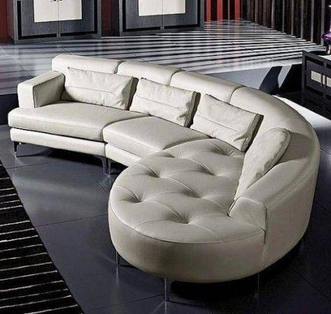 Contemporary white leather sofa placed in a minimalist home