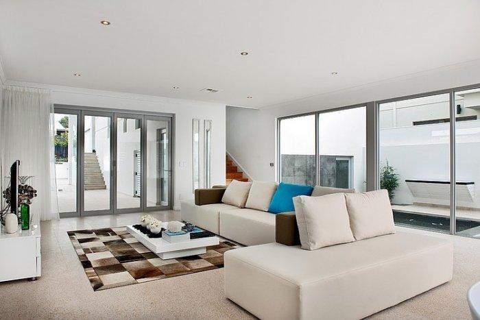 Contemporary white living room with comfortable sofas