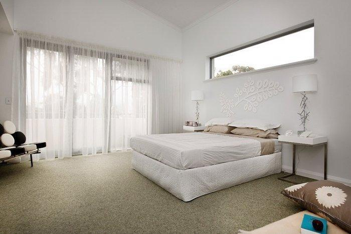 Cozy white bedroom in a coastal house in Australia