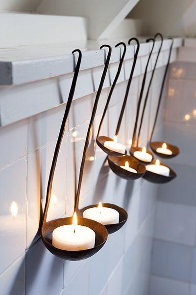 Creative candleholders used in the bathroom of the apartment