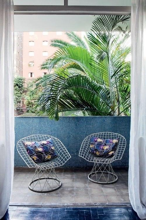 Creative outdoor chairs with colorful pillows