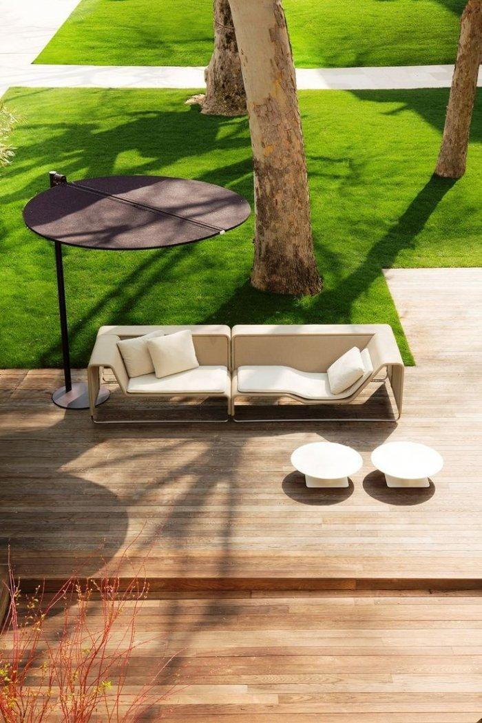 Creative white sofas in a beautiful garden