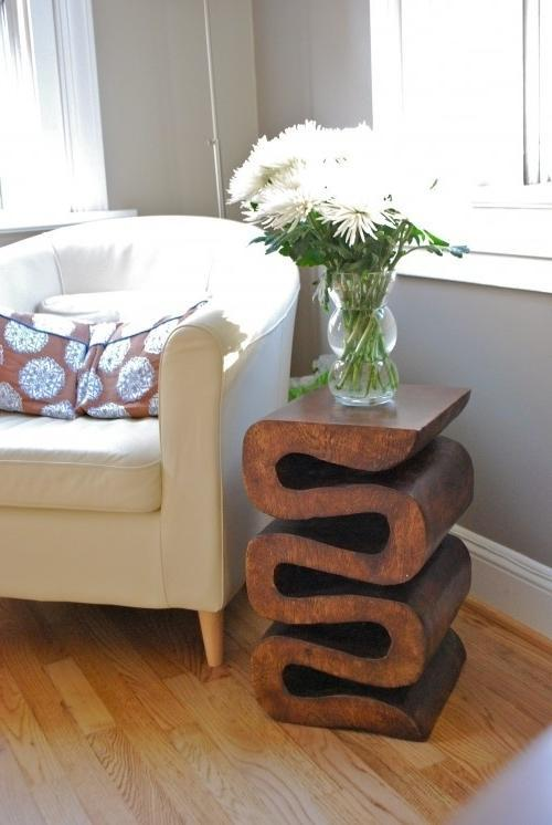 Creative wood table used as a base for flower decorations
