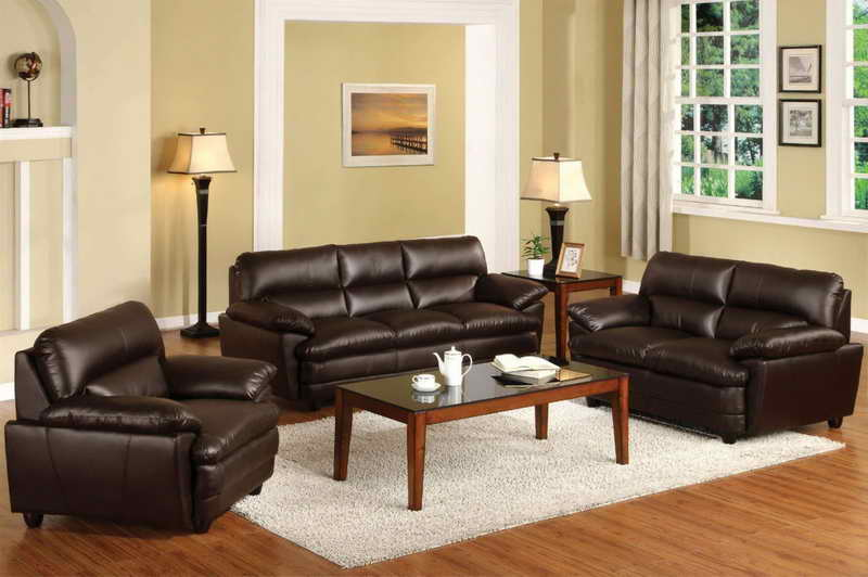 Dark brown leather sofas in a house living room