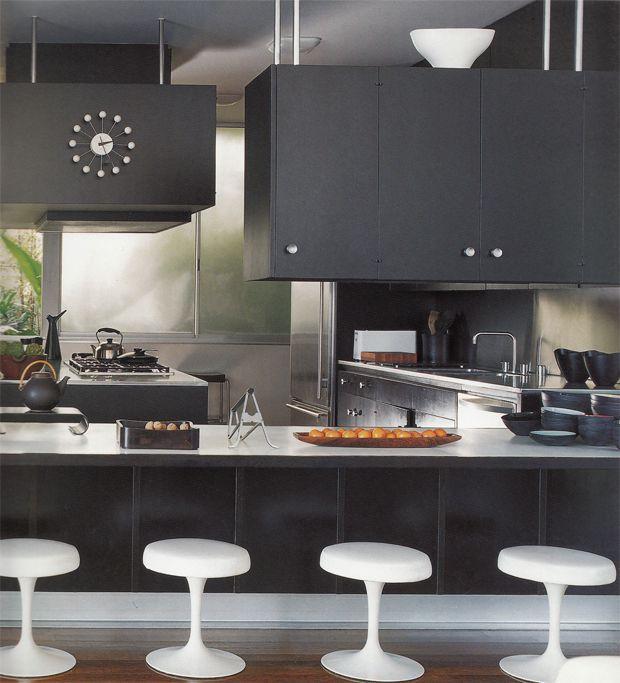 Dark kitchen design with whtie bar stools