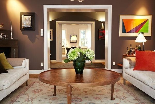 Ecleclic living room with abstract paintings