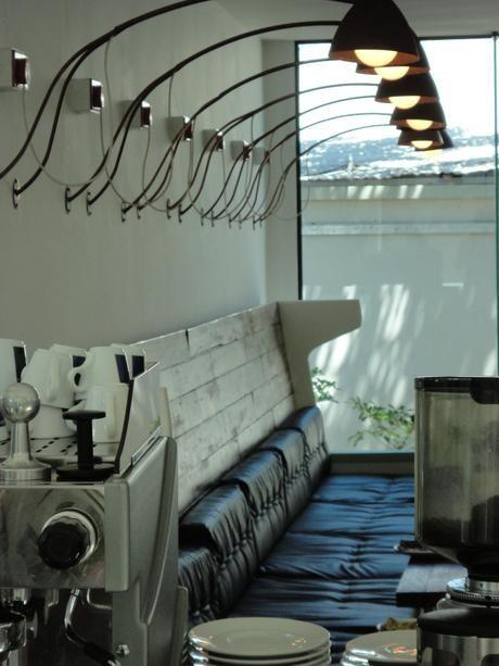 Eclectic cafe interior with industrial modern pendants
