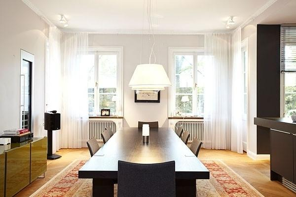 Eclectic dining room with long dining table