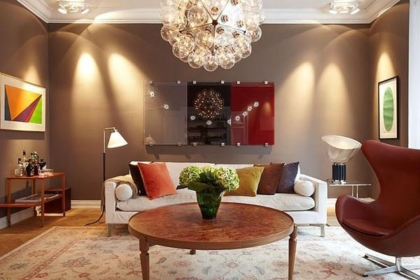 Eclectic living room with brown walls