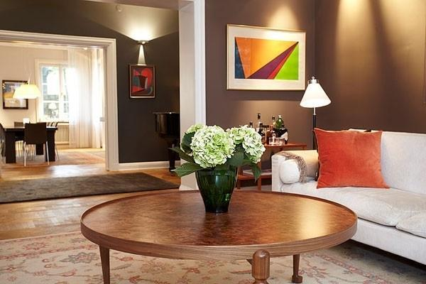 Eclectic living room with round wood table