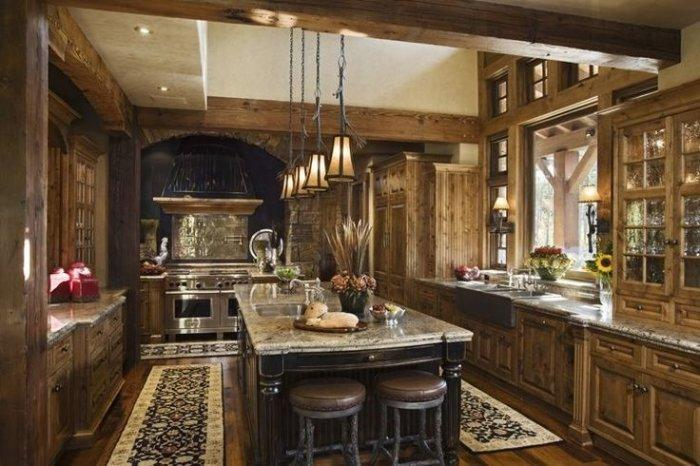Elegant mountain log kitchen with massice wood cabinets