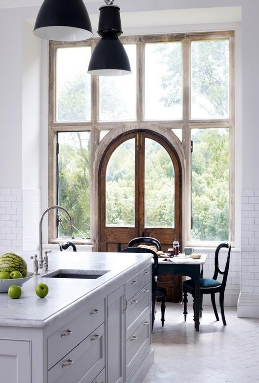 French white kitchen with floor to ceiling windows