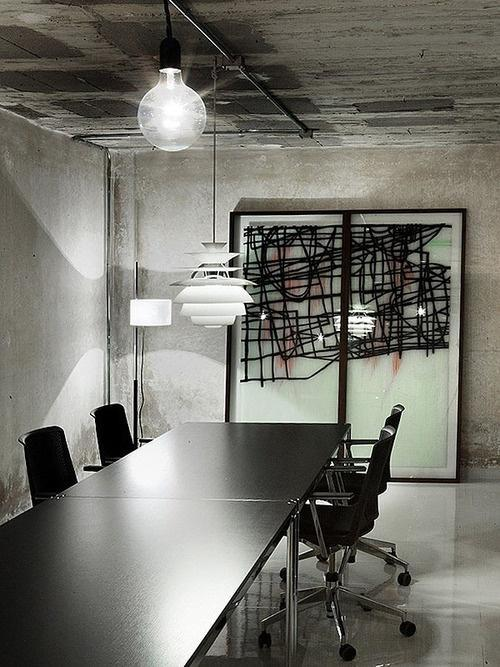 Industrial office conference room with abstract piece of art